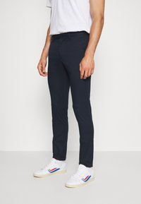 Tommy Hilfiger - BLEECKER FLEX SOFT  - Trousers - blue - 0
