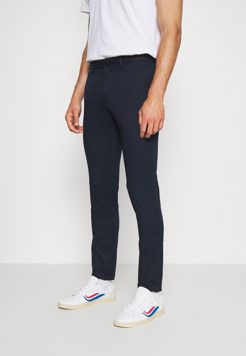 Tommy Hilfiger - BLEECKER FLEX SOFT  - Trousers - blue