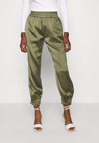 Guess - EUPHEMIA - Tracksuit bottoms - greek olive - 0