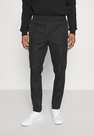 SMITHY TROUSERS - Cargo trousers - black