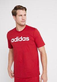 adidas Performance - LIN TEE - Print T-shirt - red - 0