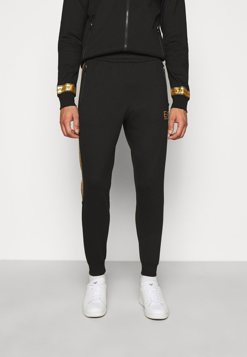 EA7 Emporio Armani - Tracksuit bottoms - black/gold