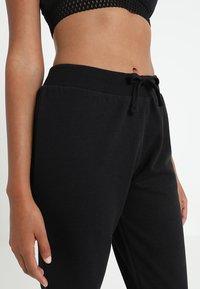 Zalando Essentials - Pyjama bottoms - black - 4