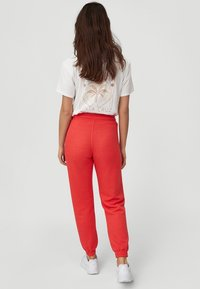 O'Neill - GRAPHIC - Tracksuit bottoms - hot coral - 1