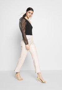 Topshop - LOVE FOOL BIKER - Trousers - offwhite - 1