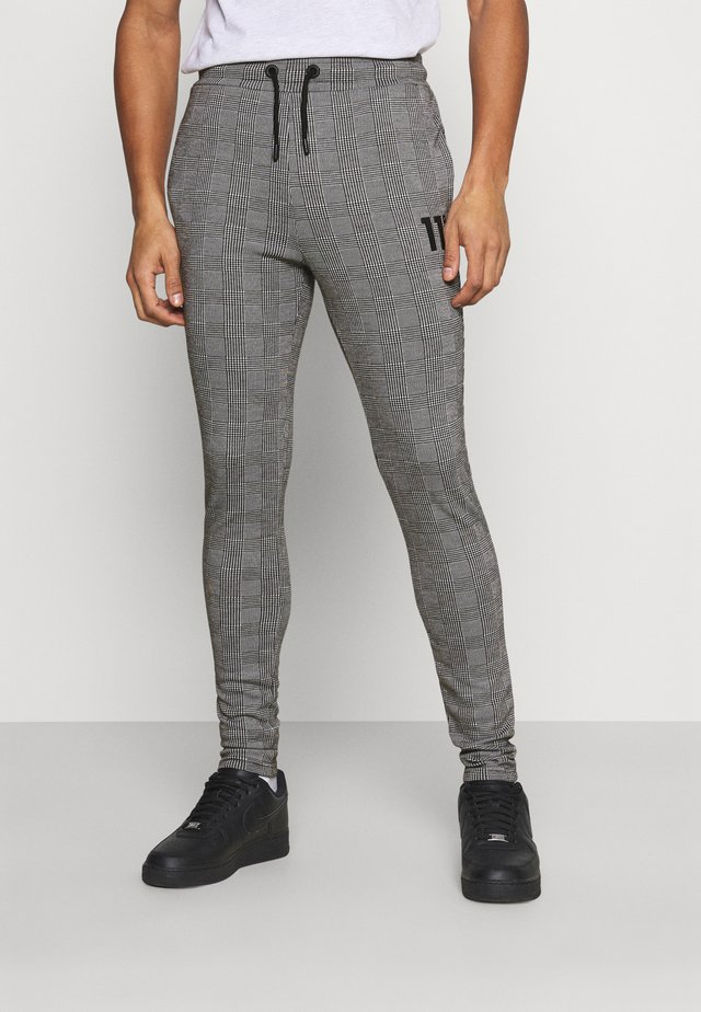 PRINCE OF WALES JOGGER - Träningsbyxor - black/white