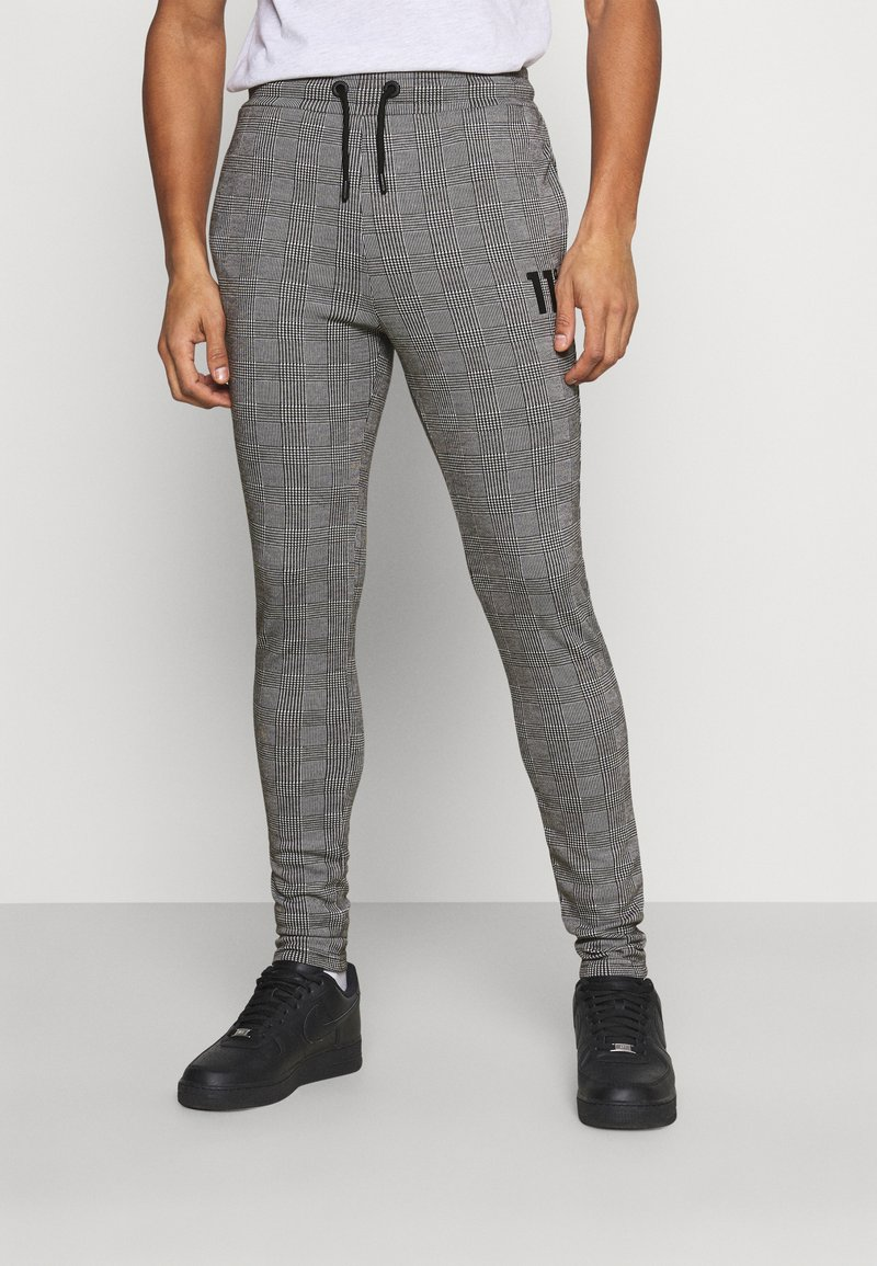11 DEGREES - PRINCE OF WALES JOGGER - Tracksuit bottoms - black/white