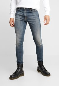 Diesel - D-AMNY-X - Slim fit jeans - blue denim - 0