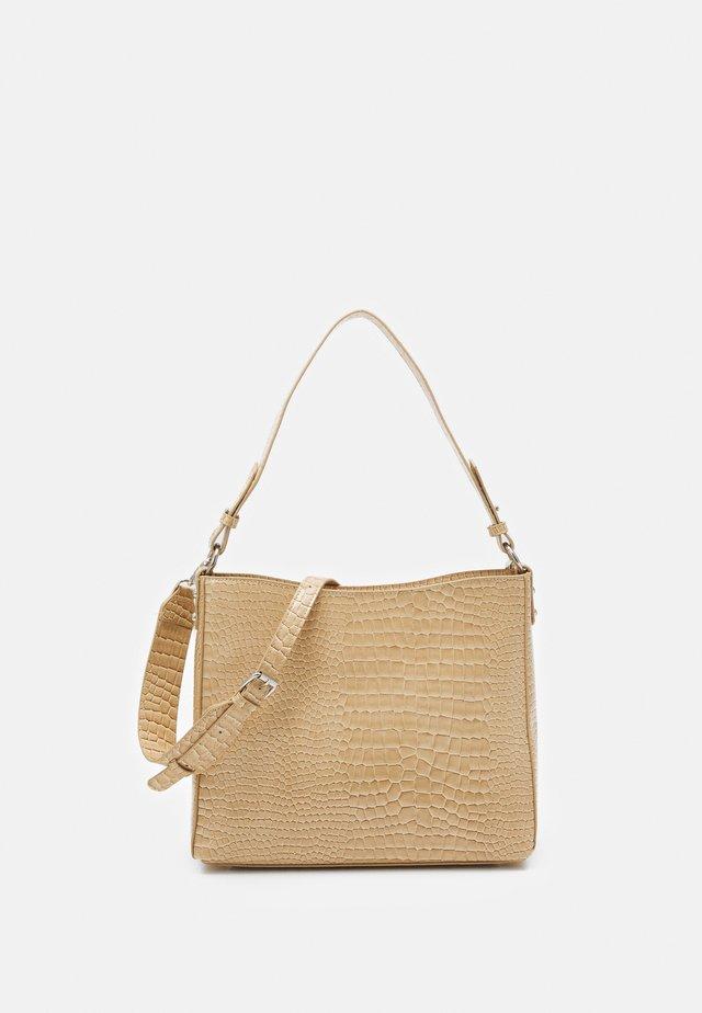 AMBLE CROCO - Handbag - light beige