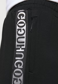 HUGO - NENNIFER - Pantalones deportivos - black - 5