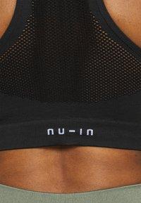 NU-IN - SPORTS BRA - Light support sports bra - black - 4