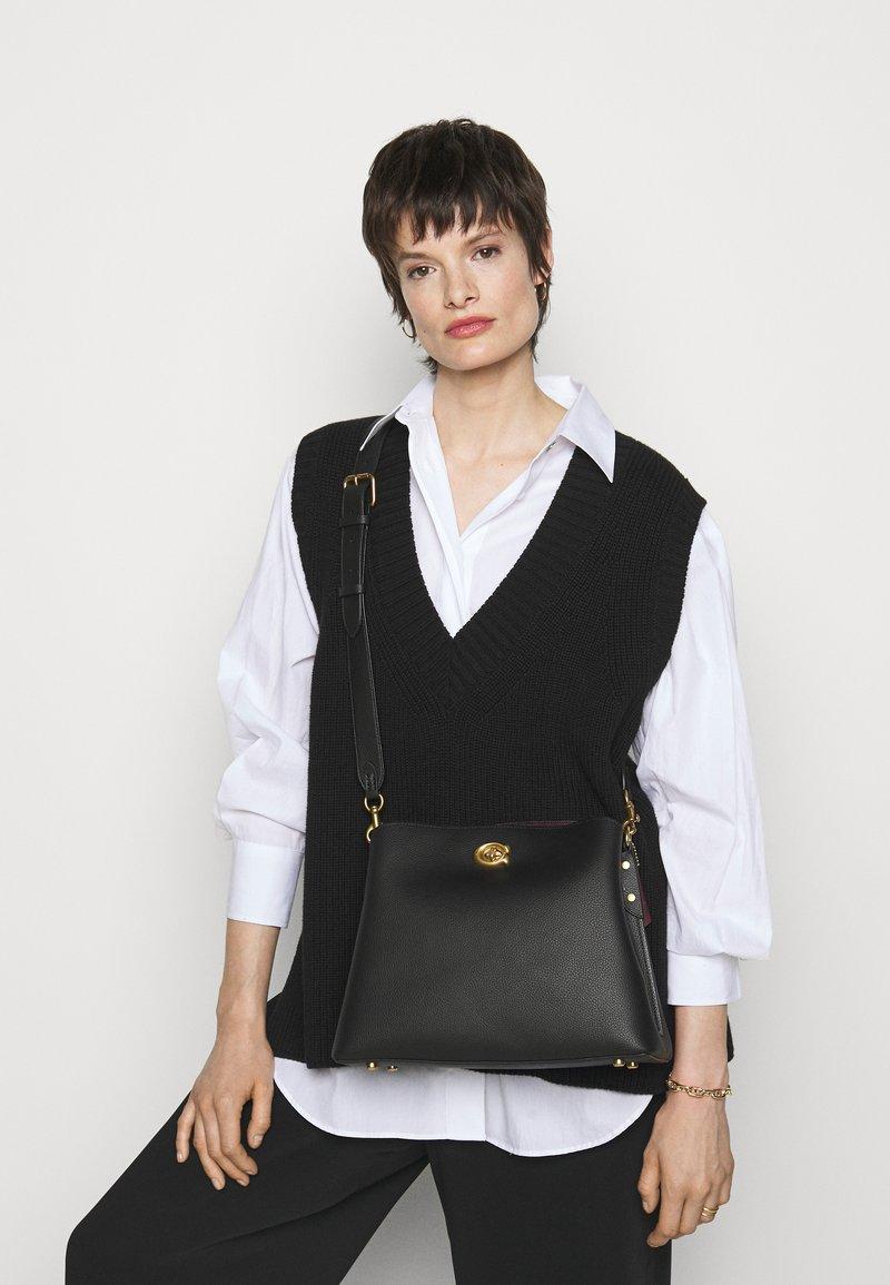 Coach - POLISHED PEBBLE WILLOW SHOULDER BAG - Handbag - black