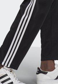 adidas Originals - FIREBIRD UNISEX - Tracksuit bottoms - black - 3