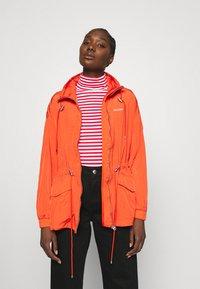 Calvin Klein - PACKABLE JACKET - Summer jacket - fiesta - 0