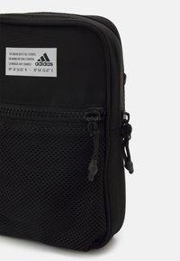 adidas Performance - ORGANIZER UNISEX - Across body bag - black - 4