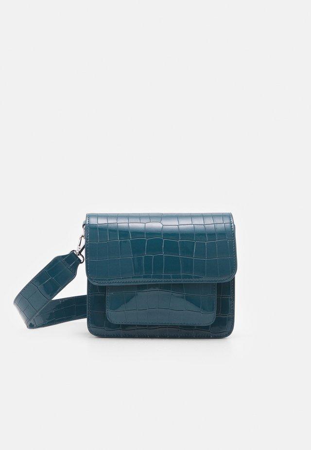 CAYMAN POCKET - Across body bag - dark blue