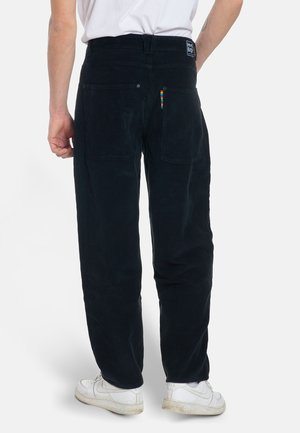 X-TRA BAGGY - Trousers - black