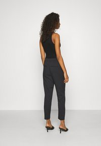 Vero Moda - VMCHIC ANKLE PANTS - Trousers - black - 2