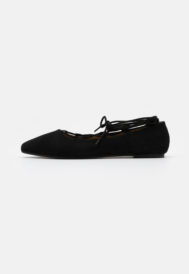 ANYTA - Ankle strap ballet pumps - black