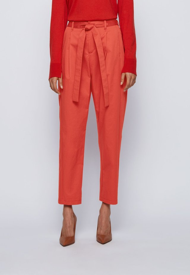TERMINE - Trousers - dark orange
