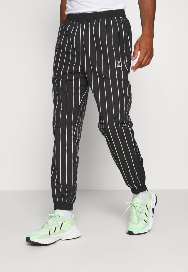 PINSTRIPE TRACK PANTS - Tracksuit bottoms - black
