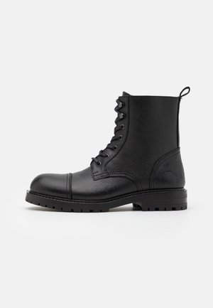 ALEXANDER - Lace-up ankle boots - black