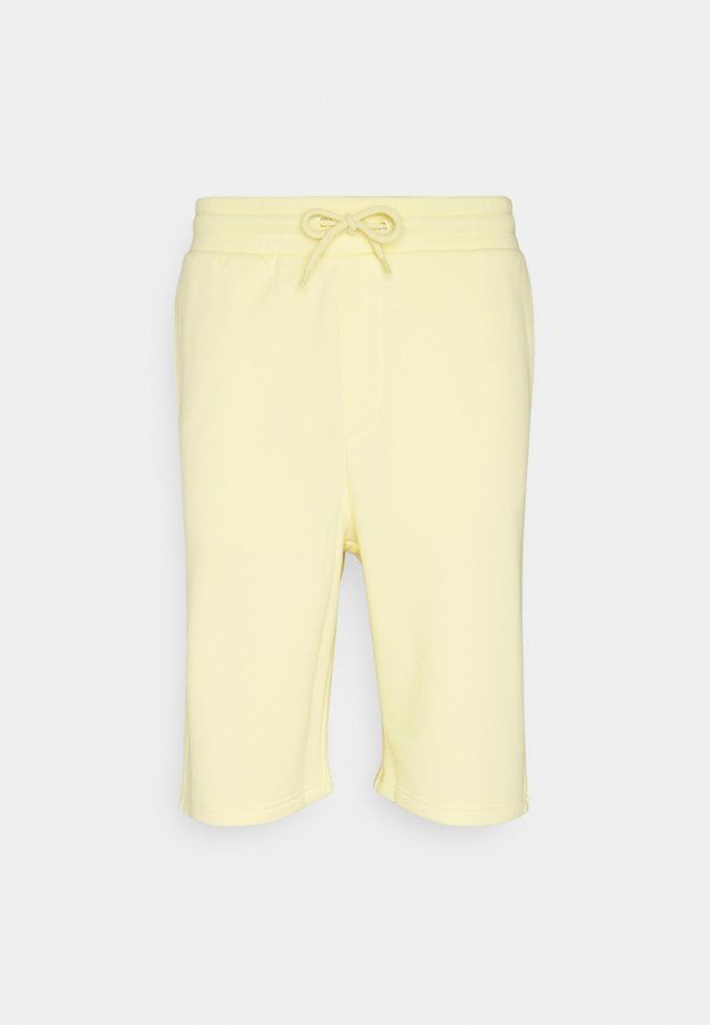 UNISEX - Träningsbyxor - yellow