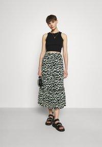 ONLY - ONLPELLA SKIRT - Maxi skirt - black/green milieu - 1