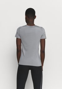 Nike Performance - ALL OVER - Camiseta básica - smoke grey/black - 2