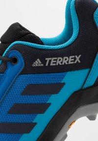 adidas Performance - TERREX AX3 - Hiking shoes - glow blue/legend ink/shock cyan - 5