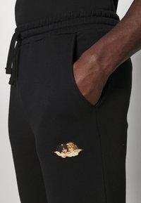 Fiorucci - ICON ANGELS - Teplákové kalhoty - black - 4