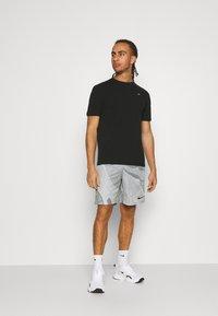 Tommy Hilfiger - BLOCKED TEE - Print T-shirt - black - 1