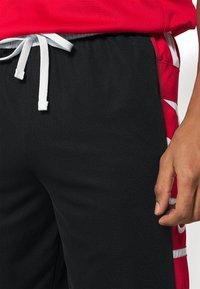 Nike Performance - Pantaloncini sportivi - black/white/university red - 3