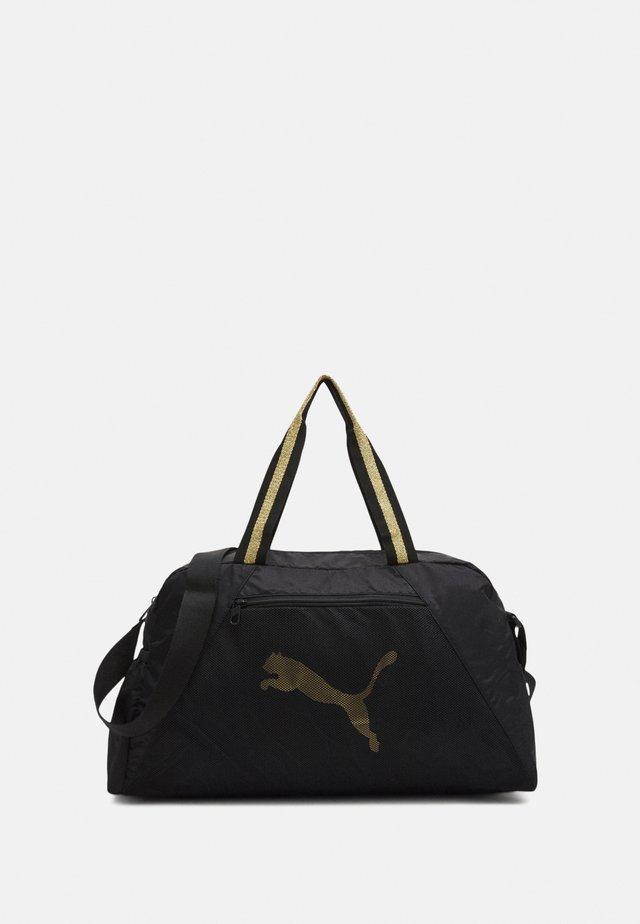 GRIP BAG 25 L - Sac de sport - black/bright gold