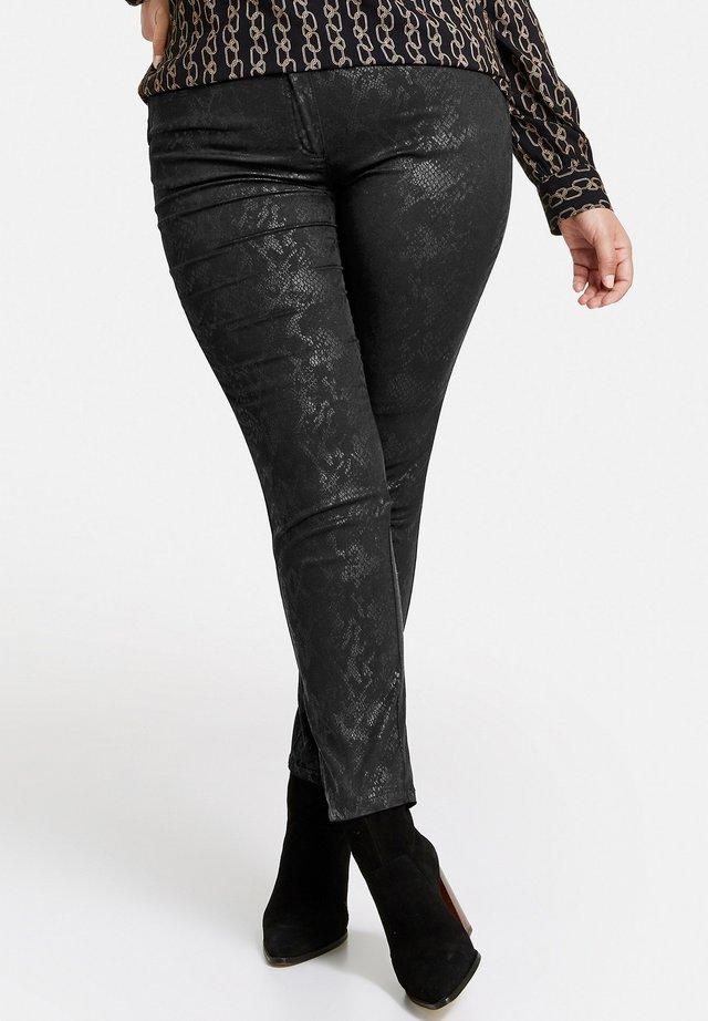MIT GLÄNZENDEM SNAKE-PRINT - Jeans Skinny Fit - black gemustert