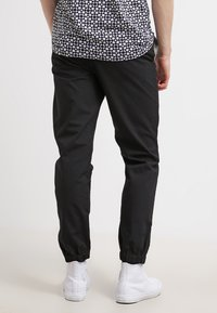 Carhartt WIP - MARSHALL COLUMBIA - Trousers - black rinsed - 2