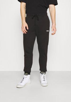 HOUSE UNISEX - Pantalon de survêtement - black