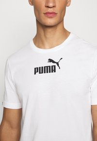 Puma - AMPLIFIED TEE - Print T-shirt - white - 5