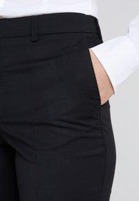 Filippa K - EMMA CROPPED COOL TROUSER - Trousers - black - 4