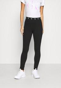 Calvin Klein Jeans - MILANO TRIM - Leggings - Trousers - black - 0