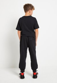 Nike Sportswear - AIR - Trainingsbroek - black/white - 2