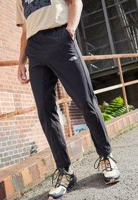 The North Face - TECH PANT - Pantalon de survêtement - black - 2