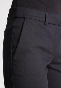 KIOMI - Spodnie materiałowe - black - 4