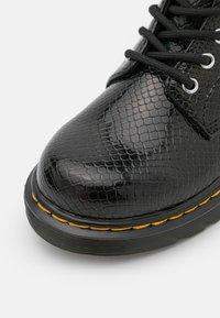 Dr. Martens - 1460 - Lace-up ankle boots - black - 5