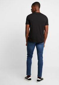 Armani Exchange - T-shirt med print - black - 2