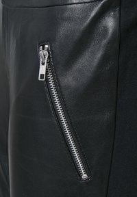 Kaffe - Leather trousers - black deep / gold - 4