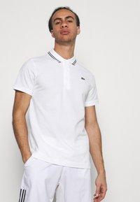 Lacoste Sport - DETAILED COLLAR - Poloshirt - white/black - 0