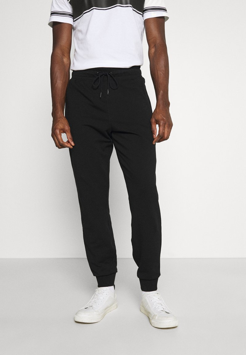 Guess - ADAM PANT - Pantaloni sportivi - jet black