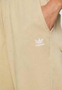 adidas Originals - CUFFED  - Tracksuit bottoms - linen khaki - 5