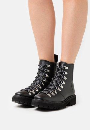 NANETTE VEGAN - Lace-up ankle boots - black